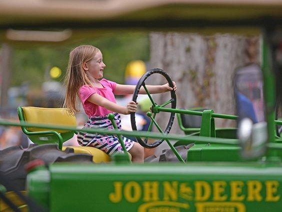 W kid on tractor.jpg