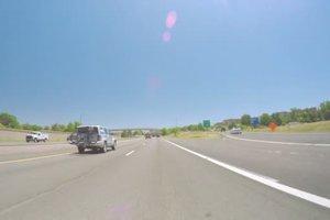 depositphotos_118221378-stock-video-car-driving-on-interstate-highway.jpg