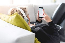 listening-to-music-on-a-sofa_free_stock_photos_picjumbo_DSC07514-1080x720.jpg